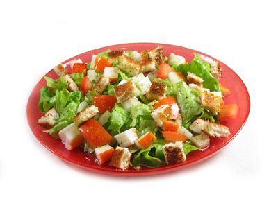 Ensalada de cangrejo, toronja, palta y hierbas